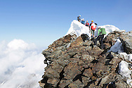 Alpinists on the summit ridge.<br /> <br /> &ldquo;Matterhorn 150 years Cervino&rdquo; - The year 2015 is the 150th Anniversary of the first ascent by Edward Whymper from the Swiss side (14th July) and by Jean Antoine Carrel from the Italian side on the 17th July 1865.<br /> <br /> On 17th July 2015 a friendship convention was signed by the members of Swiss, French, British and Italian climbing teams. A ceremony was held at the summit in honour of the mountain.