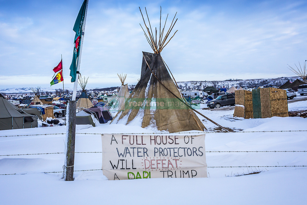December 2, 2016 - Cannonball, North Dakota, United States - An estimated ten thousand water protectors, both indigenous and non-native allies, are now occupying The Oceti Sakowin Camp in Cannonball, North Dakota. The fight to stop the 3.8 billion dollar Dakota Access Pipeline, which will pump half-a-million barrels of crud a day beneath the Missouri river if completed, has been going on for months. (Credit Image: © Michael Nigro/Pacific Press via ZUMA Wire)
