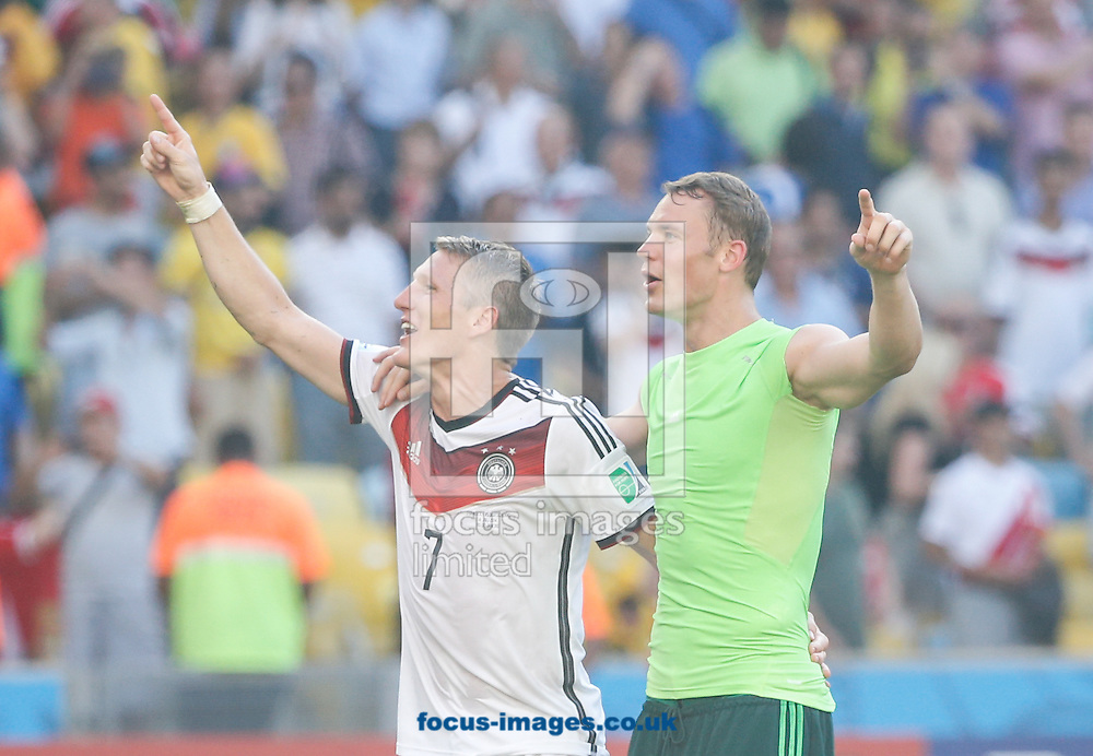 Manuel Neuer of Germany (R) and Bastian Schweinsteiger of Germany (L) celebrate after winning 0-1 during the 2014 FIFA World Cup match between France and Germany at the Maracana Stadium, Rio de Janeiro<br /> Picture by Andrew Tobin/Focus Images Ltd +44 7710 761829<br /> 04/07/2014