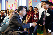 Zanker ASB President Willem Labucay (12) shakes hands with KLA-Tencor Vice President Oreste Donzella after delivering a speech during the KLA-Tencor Computer Lab opening ceremony at Zanker Elementary School in Milpitas, California, on February 27, 2013. (Stan Olszewski/SOSKIphoto)