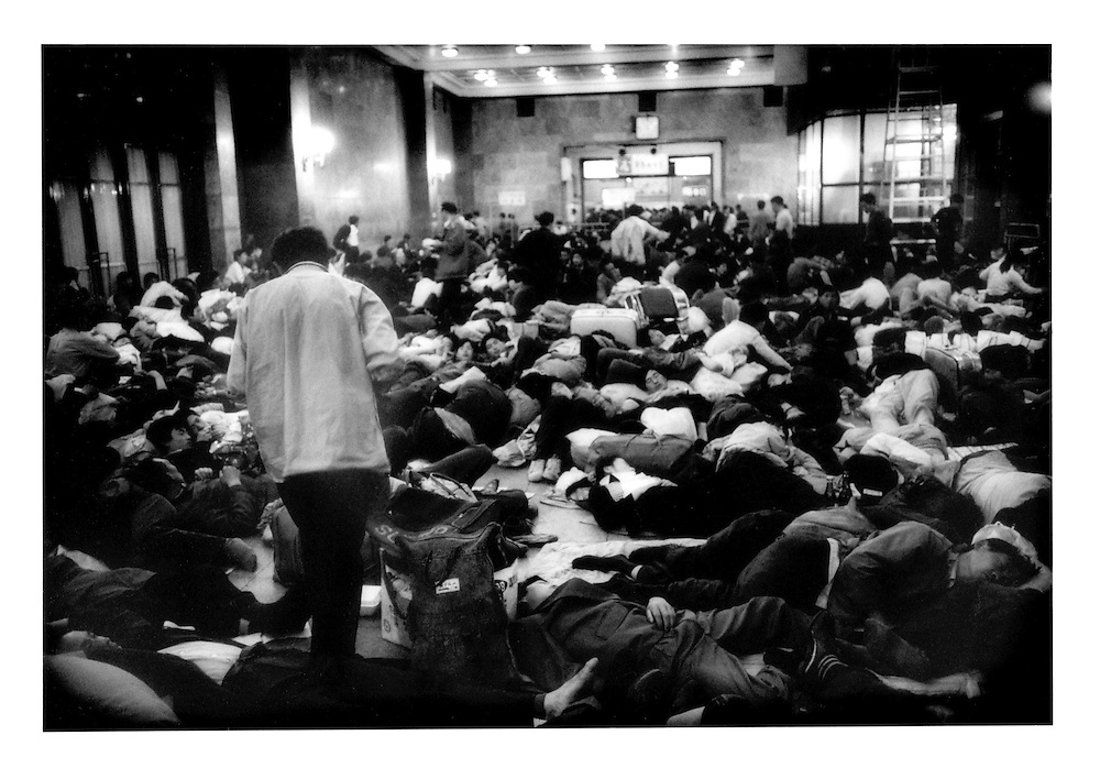 Homeless migrants from the countryside sleep in the Beijing Train Terminal.  Beijing, China.  1994