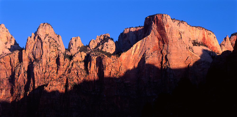 USA, Utah, Zion National Park, Sunrise lights Towers of the Virgin in Zion Canyon