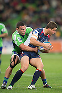 Angus Roberts (Rebels) is tackled by Kade Poki (Highlanders) during Round 17 match of the 2013 Super Rugby Championship between RaboDirect Rebels vs Highlanders at AAMI Park, Melbourne, Victoria, Australia. 12/07/0213. Photo By Lucas Wroe