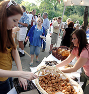 Folks gets samples from Panera Bread during the 21st annual The Taste in the Lincoln Park Commons area at the Fraze Pavilion, Thursday, September 3, 2009.