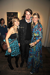 Left to right, CAMILLA BOLER, GEORGE SIMON and artist SARAH-JANE BOLER at an exhibition of Sarah-Jane Boler's paintings entitled 'Life on The Farm' held at The Troubadour, 265 Old Brompton Road, London on 27th November 2008.