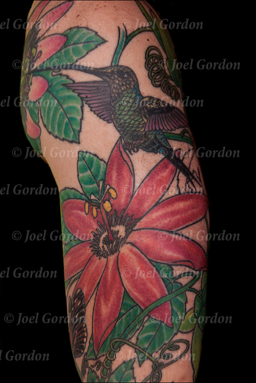 Humming Bird and Flowers on his right shoulder and arm.<br />