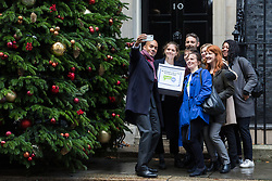 London, UK. 3rd December, 2018. A group including People's Vote spokesman Chuka Umunna MP, Caroline Lucas MP, Justine Greening MP, co-founder of Our Future Our Choice Lara Spirit and editor of the Independent Christian Broughton poses for a selfie before delivering a Final Say petition signed by over a million people to 10 Downing Street to be presented to Prime Minister Theresa May following her return from the G20 summit in Buenos Aires.