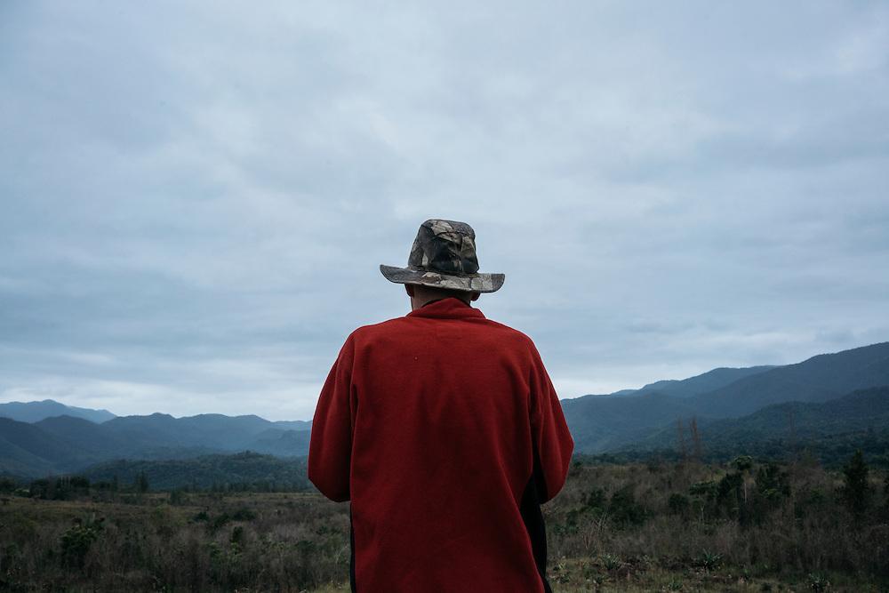 Ornithologist Martjan Lammertink, center, looks at the mountainsides on the way to Farallones on Jan, 24, 2016.