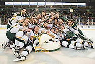 Vermont poses for a team photo after winning the men's hockey game between the Vermont Catamounts and the Quinnipiac Bobcats in the championship game of the Friendship Four hockey tournament at the SSE Arena on Saturday evening November 26, 2016 in Belfast, Ireland. (BRIAN JENKINS/for the FREE PRESS)