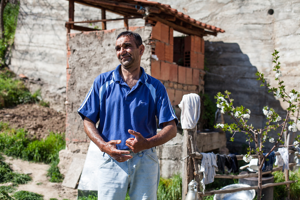 Portrait of a man in his garden living in the Roma part of the city of Crnik, Macedonia.