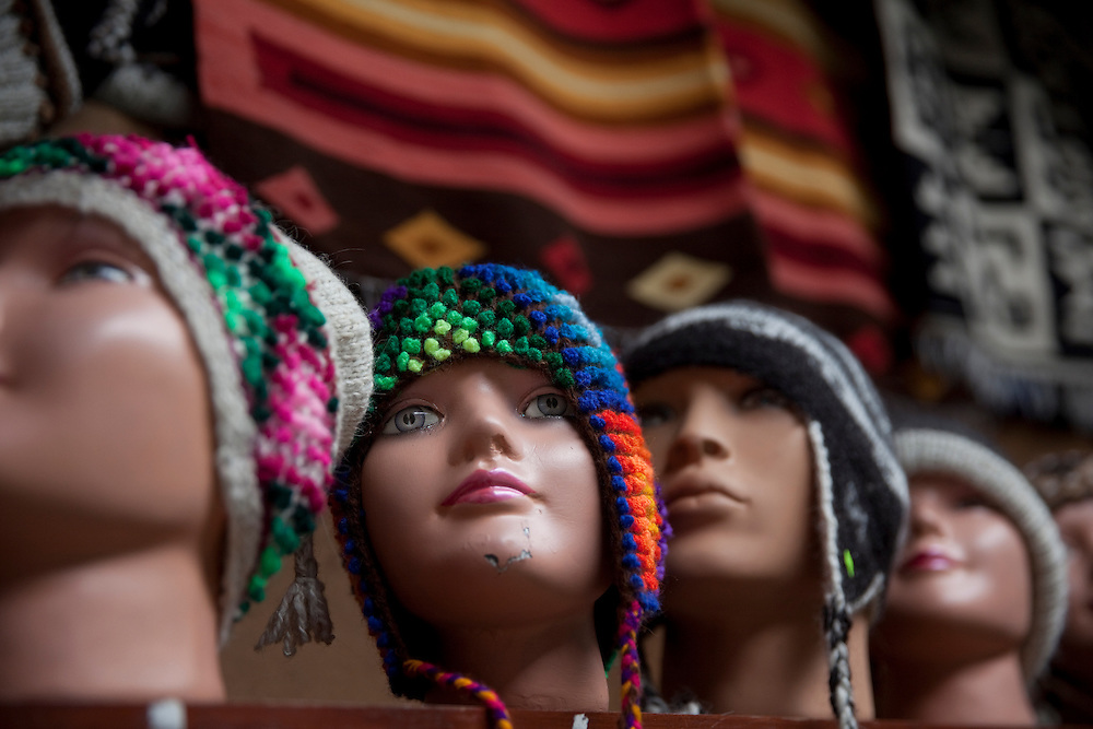mannequin heads dressed with traditional peruvian clothes at a market in Lima, Peru.