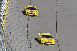 March 4, 2018 - Las Vegas, NV, U.S. - LAS VEGAS, NV - MARCH 04: Ryan Blaney (12) Team Penske Ford Fusion and Joey Logano (22) Team Penske Pennzoil Ford Fusion drive into the trioval during the Monster Energy NASCAR Cup Series Pennzoil 400 on March 04, 2018 at Las Vegas Motor Speedway in Las Vegas, NV. (Photo by Chris Williams/Icon Sportswire) (Credit Image: © Chris Williams/Icon SMI via ZUMA Press)