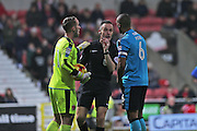 Fleetwood keeper Alex Cairns (21) caught time wasting by the referee  Darren Deadman second half 1-1  during the EFL Sky Bet League 1 match between Swindon Town and Fleetwood Town at the County Ground, Swindon, England on 17 December 2016. Photo by Gary Learmonth.
