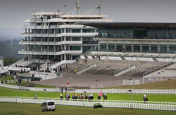 © Licensed to London News Pictures. 04/07/2020. Epsom, UK. Serpentine heads to victory in The Investec Derby past an empty grand stand at Epsom. Today's race meeting is being held behind closed doors due to the coronavirus lockdown rules. Seven races are being held in one day including The Oaks, with The Derby being run at 17:30pm. Photo credit: Peter Macdiarmid/LNP