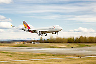 Asiana Cargo jet landing at Ted Stevens Anchorage International Airport in Southcentral Alaska with the Chugach Mountains in the background. Spring. Afternoon.