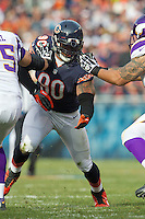 25 November 2012: Defensive end (90) Julius Peppers of the Chicago Bears rushes against the Minnesota Vikings during the first half of the Bears 28-10 victory over the Vikings in an NFL football game at Soldier Field in Chicago, IL.