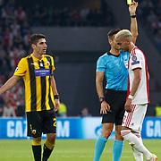 NLD/Amsterdam/20180919 - Ajax - AEK, scheidsrechter Carlos Del Cerro geeft eem gele kaart