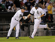 CHICAGO - JULY 31:  Third base coach Jeff Cox #8 greets Carlos Quentin #20 of the Chicago White Sox after Quentin hit a home run in the third inning against the New York Yankees on July 31, 2009 at U.S. Cellular Field in Chicago, Illinois.  (Photo by Ron Vesely)