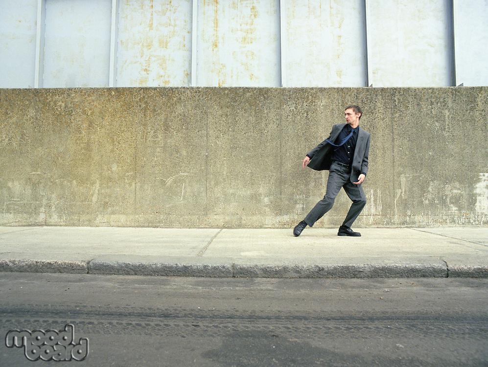 Businessman Walking on Street