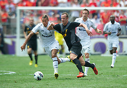 BALTIMORE, MD - Saturday, July 28, 2012: Liverpool's Charlie Adam in action against Tottenham Hotspur's Jake Livermore during a pre-season friendly match at the M&T Bank Stadium. (Pic by David Rawcliffe/Propaganda)