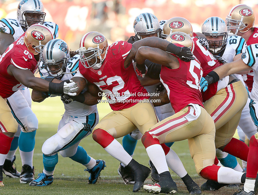 10 November 2013: 49ers linebacker Patrick Willis (52) wraps up DeAngelo Williams during action in an NFL game against Carolina at Candlestick Park in San Francisco, CA. The Panthers won 10-9.