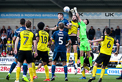 Kieran O'Hara of Burton Albion punches the ball clear from Ollie Clarke of Bristol Rovers - Mandatory by-line: Robbie Stephenson/JMP - 31/08/2019 - FOOTBALL - Pirelli Stadium - Burton upon Trent, England - Burton Albion v Bristol Rovers - Sky Bet League One