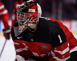 Eric Comrie of the Tri-City Americans represented Team Canada at the opening game of the 2015 World Junior Championships in Montreal, Quebec on Friday Dec. 26, 2014. Canada defeated Slovakia 8-0. Photo by Aaron Bell/CHL Images.