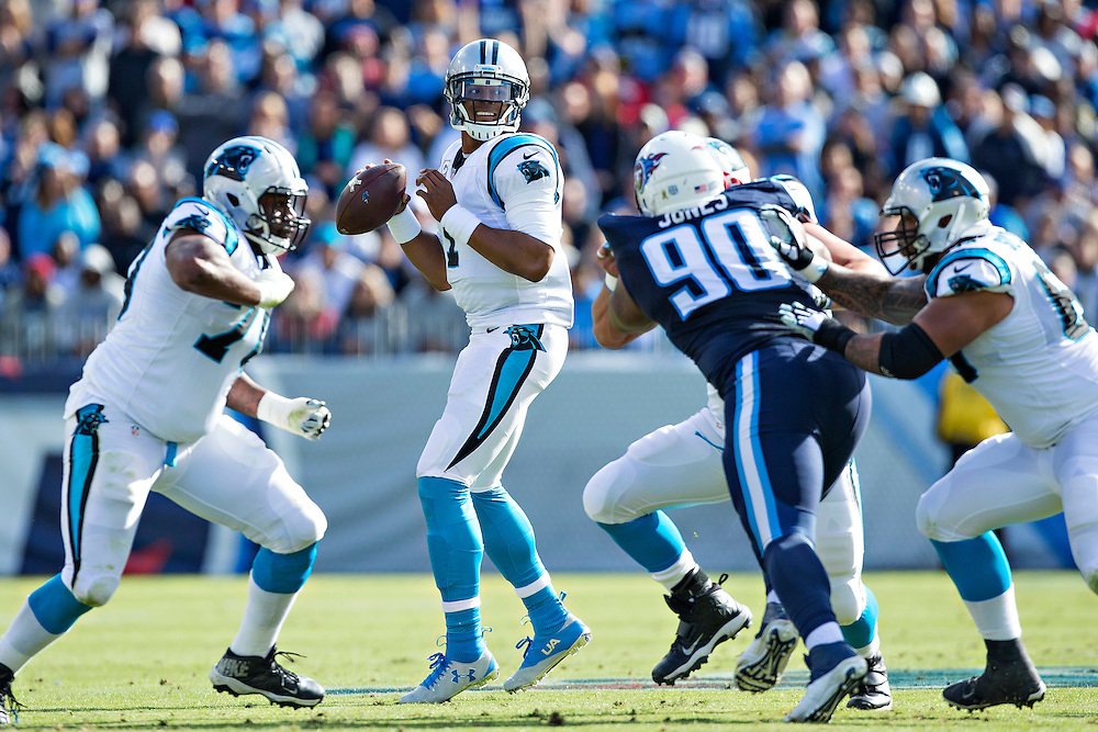 NASHVILLE, TN - NOVEMBER 15:  Cam Newton #1 of the Carolina Panthers drops back to pass under pressure during a game against the Tennessee Titans at Nissan Stadium on November 15, 2015 in Nashville, Tennessee.  (Photo by Wesley Hitt/Getty Images) *** Local Caption *** Cam Newton