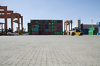 Limassol Cyprus Mobile crane moving containers in stockyard