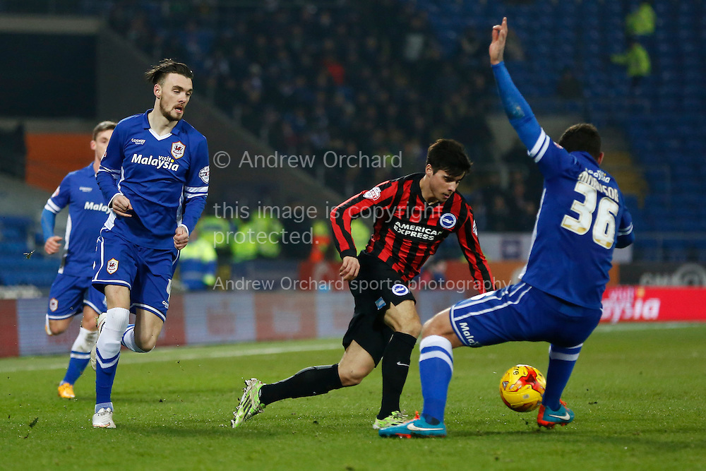 Joao Teixeira of Brighton takes the ball past Sean Morrison of Cardiff City.<br /> Skybet football league championship match, Cardiff City v Brighton &amp; Hove Albion at the Cardiff city Stadium in Cardiff, South Wales on Tuesday 10th Feb 2015.<br /> pic by Mark Hawkins, Andrew Orchard sports photography.