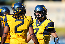 Oct 14, 2017; Morgantown, WV, USA; West Virginia Mountaineers quarterback Will Grier (7) celebrates with West Virginia Mountaineers wide receiver Ka'Raun White (2) after throwing a touchdown pass during the fourth quarter against the Texas Tech Red Raiders at Milan Puskar Stadium. Mandatory Credit: Ben Queen-USA TODAY Sports