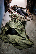 SYRIA, HOMS, Baba Amro: Dead Syrians lie down in the entrance of a house used as hospital in Baba Amro, southern neighbouhood of Homs on February 06, 2012.  ALESSIO ROMENZI