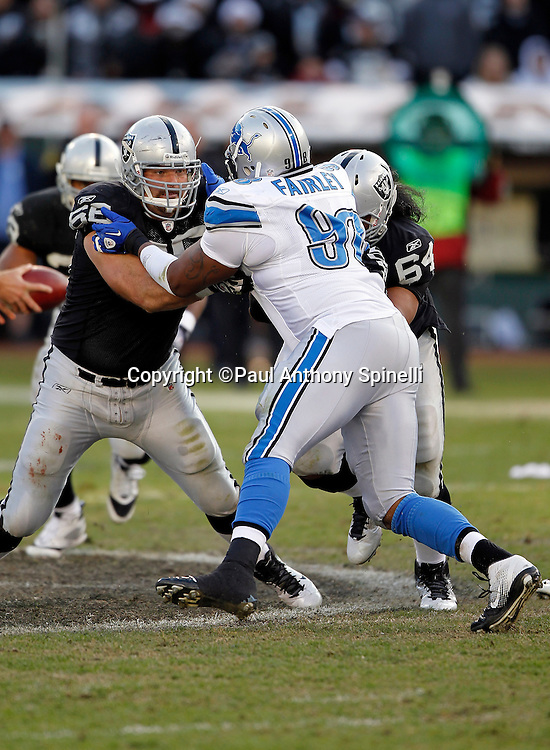 Detroit Lions defensive tackle Nick Fairley (98) works his way through a double team block during the NFL week 15 football game against the Oakland Raiders on Sunday, December 18, 2011 in Oakland, California. The Lions won the game 28-27. ©Paul Anthony Spinelli