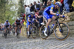 The peloton led by Kasper Asgreen (DEN) and Zdenek Stybar (CZE) Deceuninck-Quick Step on the Muur Kapelmuur Geraardsbergen during the 2019 Ronde Van Vlaanderen 270km from Antwerp to Oudenaarde, Belgium. 7th April 2019.<br /> Picture: Eoin Clarke | Cyclefile<br /> <br /> All photos usage must carry mandatory copyright credit (© Cyclefile | Eoin Clarke)