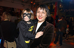 SELINA BLOW and her daughter VIOLET LEVENSON at a party to celebrate the launch of DKNY Kids and Halloween in aid of CLIC Sargent and RX Art held at DKNY, 27 Old Bond Street, London on 31st October 2006.<br /><br />NON EXCLUSIVE - WORLD RIGHTS