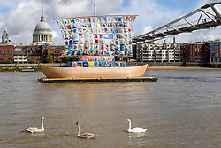 "© Licensed to London News Pictures. 04/09/2019. LONDON, UK. A swan and cygnets pass by during the photocall for the launch of ""The Ship of Tolerance"" at Tate Modern, Bankside.  The floating installation by Emilia Kabakov (of Russian conceptual artist duo Ilya and Emilia Kabakov) forms part of Totally Thames Festival and will be moored 4 September to 31 October.  The goal of the artwork is to educate and connect the youth of the world through the language of art.  Photo credit: Stephen Chung/LNP"