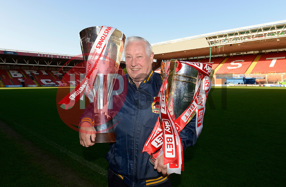 A fan poses for photos with the Johnstone Paint Trophy and Sky Bet League One trophy - Photo mandatory by-line: Dougie Allward/JMP - Mobile: 07966 386802 - 12/05/2015 - SPORT - Football - Bristol - Ashton Gate Stadium - Bristol City Academy