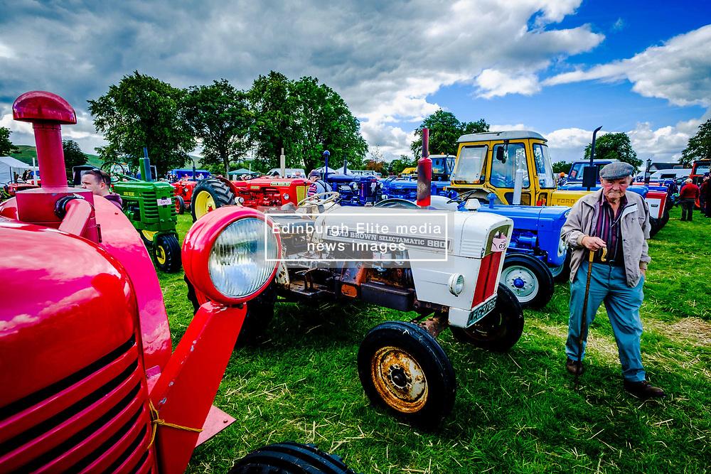 The 44th Biggar Vintage Vehicle Rally held in Biggar on 13th August 2017.  An old farmer admiring the vintage tractors.<br /> <br /> (c) Andrew Wilson | Edinburgh Elite media