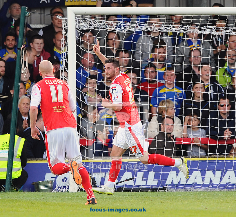 P&aacute;draig Amond of Morecambe celebrates after scoring his team's third goal from the penalty spot during the Sky Bet League 2 match at the Cherry Red Records Stadium, Kingston<br /> Picture by Seb Daly/Focus Images Ltd +447738 614630<br /> 26/04/2014