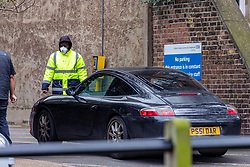 © Licensed to London News Pictures. 03/03/2020. London, UK. A security guard with a mask on checks in a driver at a Coronavirus Drive-Thru Testing Centre at Parsons Green Health Centre Fulham, West London as Boris Johnson announces his battle plan in Downing Street for combating the coronavirus crisis. Photo credit: Alex Lentati/LNP