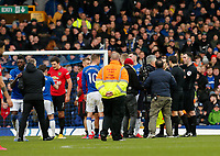 Football - 2019 / 2020 Premier League - Everton vs. Manchester United<br /> <br /> Referee Chris Kavanagh shows Everton manager Carlo Ancelotti a red card after he and his players surrounded the referee after a VAR decision ruled out a late goal by Dominic Calvert-Lewin, at Goodison Park.<br /> <br /> COLORSPORT/ALAN MARTIN