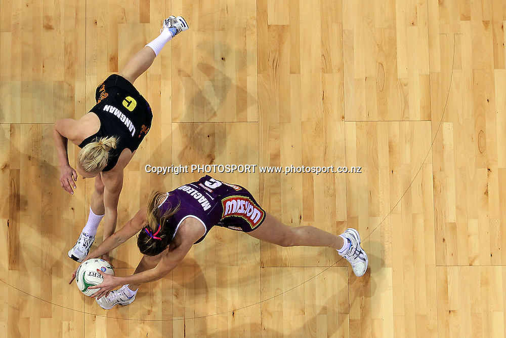 Magic's Laura Langman competes against Firebirds' Elissa Macleod for the ball. ANZ Netball Championship, Waikato/Bay of Plenty Magic v Queensland Firebirds, Claudelands Arena, Hamilton, New Zealand. Monday 2nd July 2012. Photo: Anthony Au-Yeung / photosport.co.nz