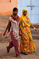 Two woman in colorful sarees walking down the street, India, Exotic people and places wall art. Fine art photography prints for sale.