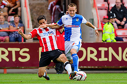 Eliot Richards of Bristol Rovers is challenged by Craig Woodman of Exeter City - Photo mandatory by-line: Rogan Thomson/JMP - Tel: Mobile: 07966 386802 03/08/2013 - SPORT - FOOTBALL - St James Park - Exeter -  Exeter City v Bristol Rovers - Sky Bet League 2
