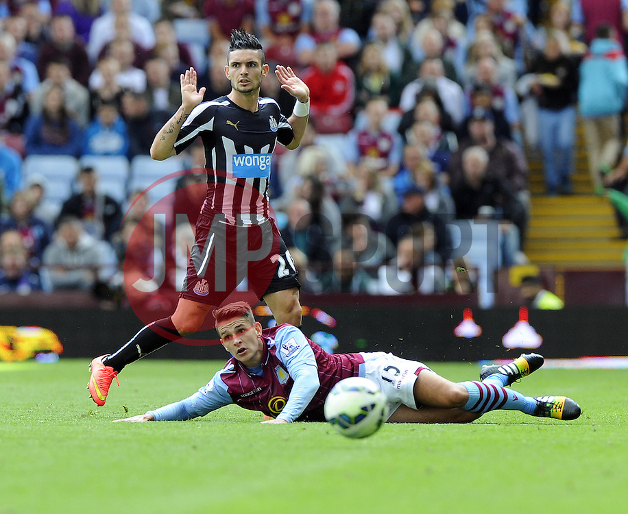 Aston Villa's Ashley Westwood is fouled by Newcastle United's Remy Cabella - Photo mandatory by-line: Joe Meredith/JMP - Mobile: 07966 386802 23/08/2014 - SPORT - FOOTBALL - Birmingham - Villa Park - Aston Villa v Newcastle United - Barclays Premier League
