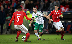 Northern Ireland's Conor Washington (centre) battles with Switzerland's Manuel Akanji (left) and Stephan Lichtsteiner during the FIFA World Cup Qualifying second leg match at St Jakob Park, Basel.