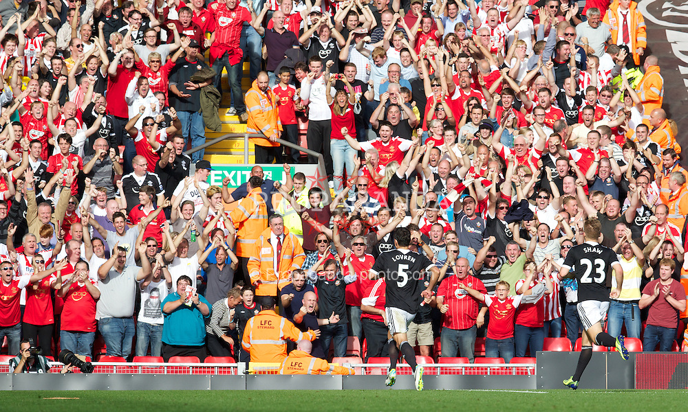 LIVERPOOL, ENGLAND - Saturday, September 21, 2013: Southampton's Dejan Lovren celebrates scoring the winning goal against against Liverpool in the Premiership match at Anfield. (Pic by David Rawcliffe/Propaganda)