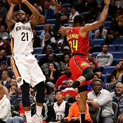 Mar 26, 2019; New Orleans, LA, USA; New Orleans Pelicans forward Darius Miller (21) shoots over Atlanta Hawks guard Kent Bazemore (24) during the second half at the Smoothie King Center. Mandatory Credit: Derick E. Hingle-USA TODAY Sports