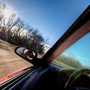 On a rural dirt road in my car near Pratt Kansas with my wide angle lens.