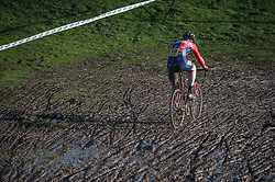A rider from VCL fits his way through themud during Round 11 of the - Central Cyclo Cross League at Stanborough Park, Welwyn Garden City, UK on 19 January 2014. Photo: Simon Parker